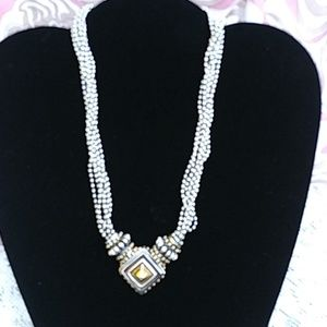 Silver & gold colored necklace.
